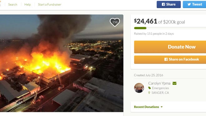 A photo of the GoFundMe.com donation page for employees of Initiative Foods shows an image of the fire that gutted the Sanger baby food manufacturer.