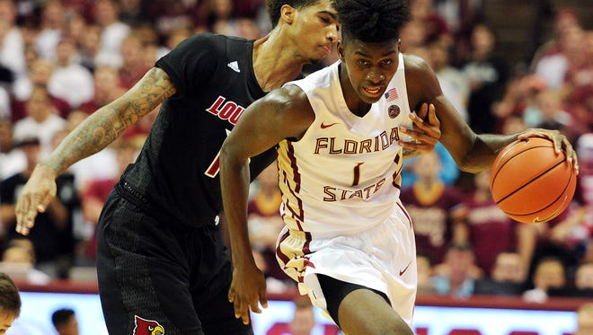Louisville's Ray Spalding tries to knock the ball away from Florida State's Jonathan Isaac during the Seminoles' win last week.