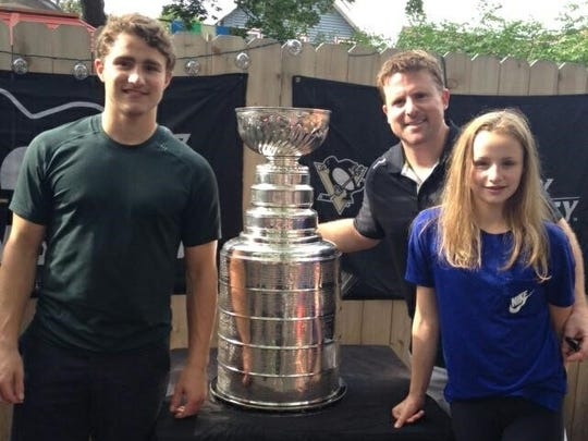 From left, Will, Dan and Maggie MacKinnon of Plymouth