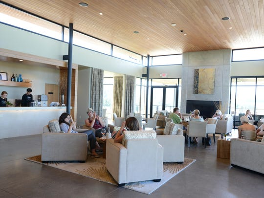 Guests stay cool in the tasting room on a warm summer day at Ponzi Vineyards in Sherwood.