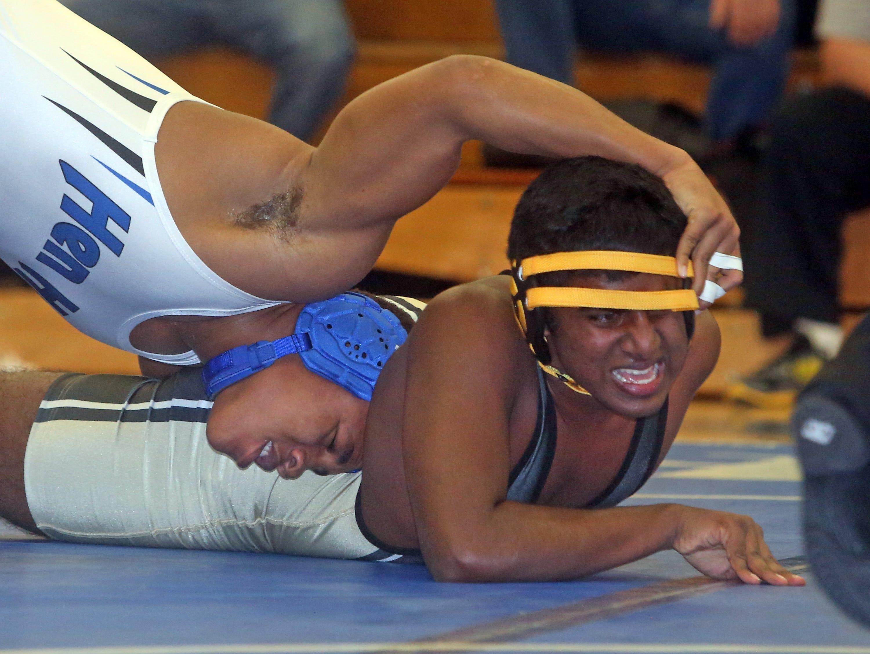 Hendrick Hudson's Jordan Artrope, left, pinned Nanuet's Nathaniel Moncy in a 182-pound match during a quad wrestling meet at Hendrick Hudson High School on Thursday.