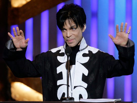 Prince accepts the award for outstanding male artist