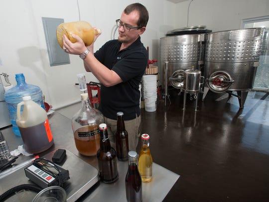 Pensacola resident John Wilson begins the brewing process