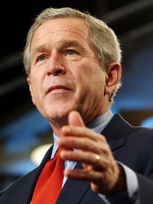 Former President George W. Bush makes closing remarks at a White House sponsored conference on the economy at the Reagan Trade Center in 2004 in Washington, DC.
