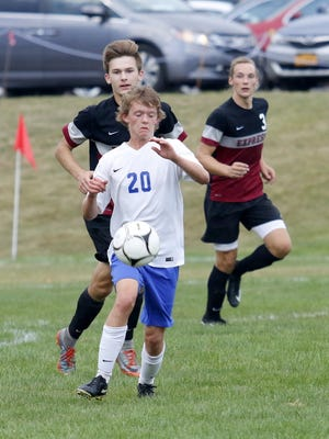 Connor Thorpe of Horseheads tries to maintain possession against Elmira on Sept. 27, 2017 at Horseheads.