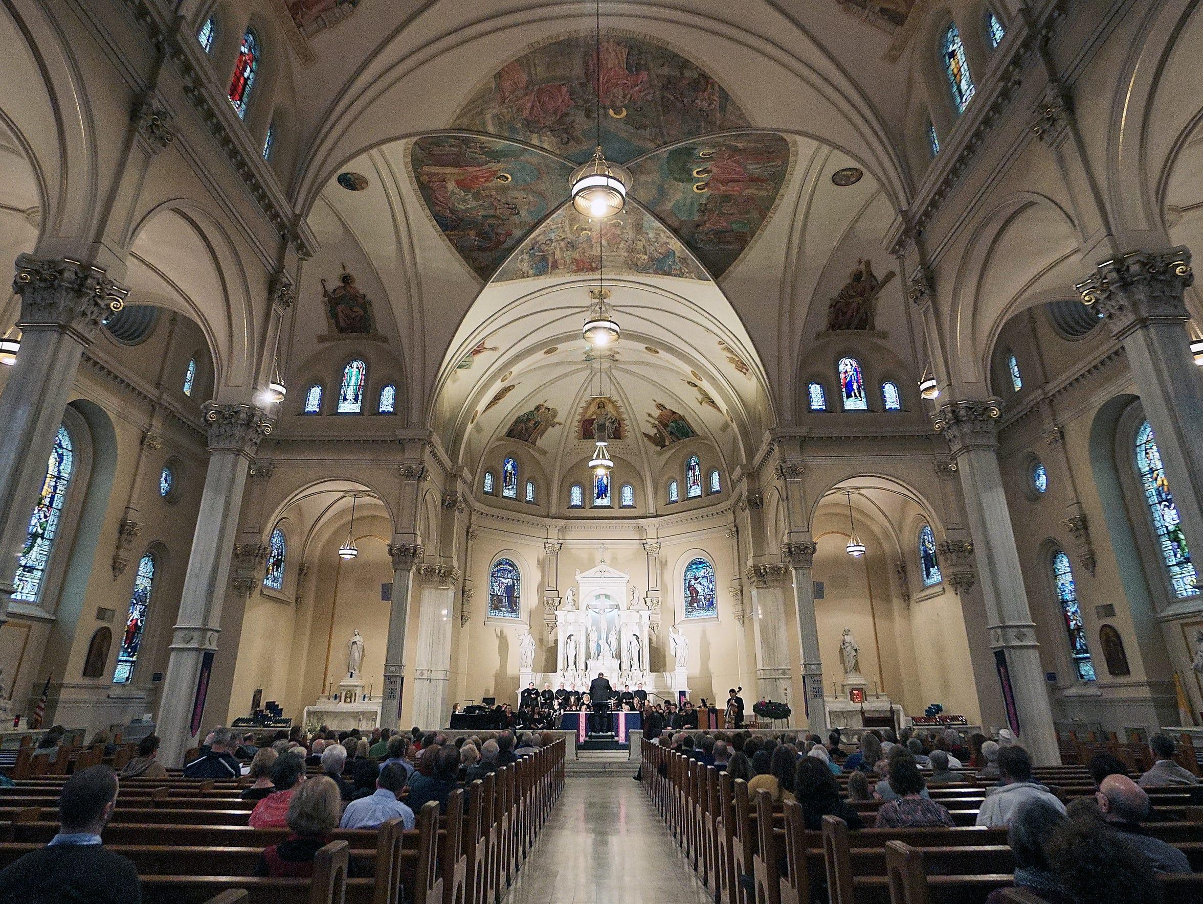 People gather at St. Peter's Catholic Church on Sunday