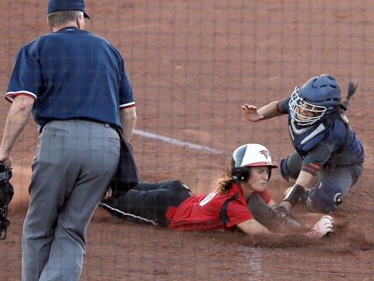 Incarnate Word's Kellen Robles is tagged out at home