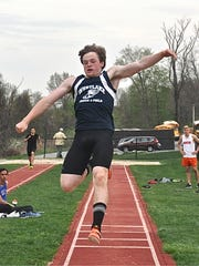 Westlake junior Dylan Ahern takes flight during the boys pentathlon long jump at the Somers Lions Joe Wynne Invitational. Photo from May 4, 2018.