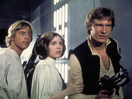 Mark Hamill, Carrie Fisher and Harrison Ford in the