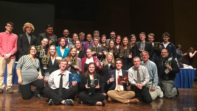 Members of the Simpson speech and debate team, which captured its first national title over the weekend.