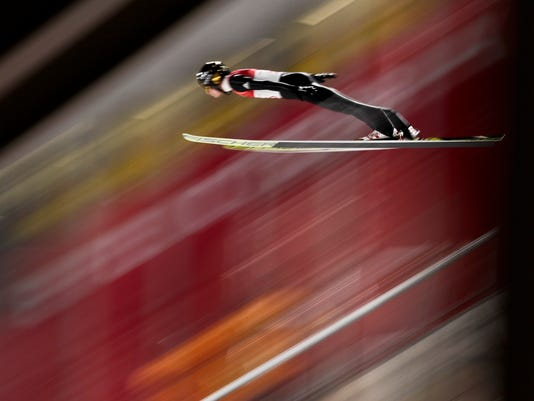 Andreas Wellinger, of Germany, soars through the air during the men's normal hill individual ski jumping qualifier ahead of the 2018 Winter Olympics in Pyeongchang, South Korea, Thursday, Feb. 8, 2018. (AP Photo/Matthias Schrader)
