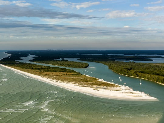 In this file photo, boaters gather on the southern end of Keewaydin Island on Dec. 30, 2013, in Naples.