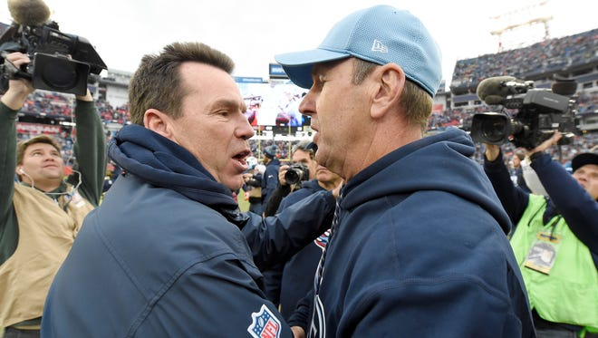 Broncos head coach Gary Kubiak and Titans head coach Mike Mularkey hug after the Titans' 13-10 win at Nissan Stadium on Dec. 11, 2016.