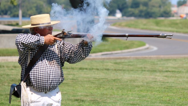 Mike Koltunak demonstrates how American militia soldiers fired flintlock muskets in the War of 1812 at the Perry's Victory and International Peace Memorial during an August 2016 weekend celebrating the 100th birthday of the National Park Service.