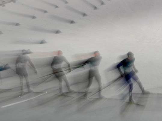 Athletes compete in the 10km cross-country skiing portion of the nordic combined event at the 2018 Winter Olympics in Pyeongchang, South Korea, Wednesday, Feb. 14, 2018. (AP Photo/Charlie Riedel)
