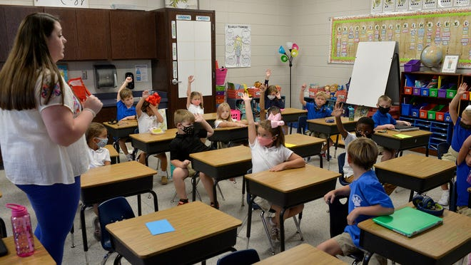 Teacher Louise Anderson ask question of her first grade class at Rincon Elementary School.