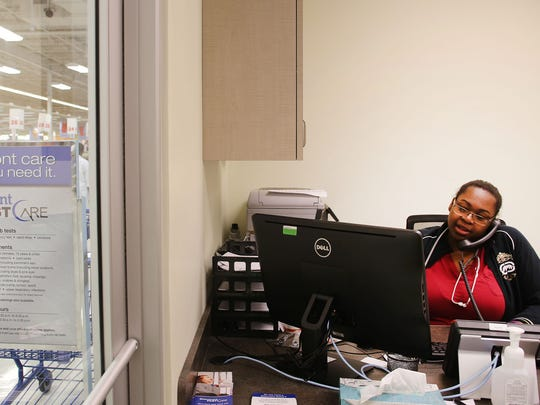 Shaina Shepard, a certified medical assistant  with Beaumont Fast Care, answers the phone Monday. The walk-in clinic accepts most health insurance plans.