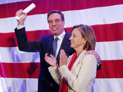 Sen mark warner d va waves to the crowd with his wife lisa collis
