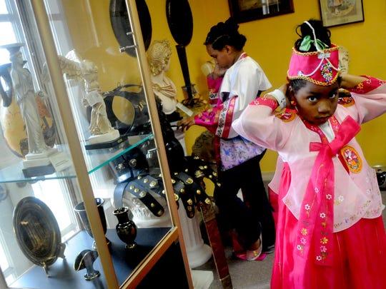 Aymardria Bell, 5, dresses in traditional Korean attire