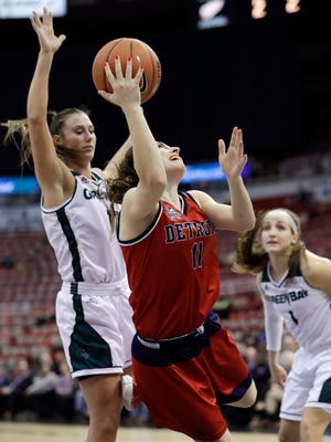 Detroit Mercy guard Rosanna Reynolds, right, shoots during the first half against Green Bay in the championship game of the Horizon League tournament Tuesday, March 7, 2017, in Detroit.