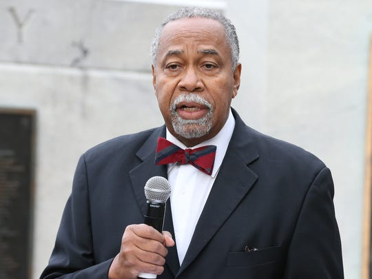 Kentucky Senator Gerald Neal speaks at a brief memorial service for Georgia Powers at Fifth and Jefferson on Monday morning.