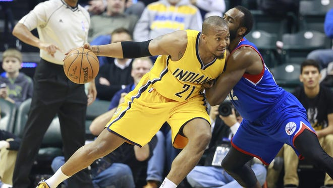 In this March 1, 2015, file photo, Indiana Pacers forward David West, left, moves to the basket defended by Philadelphia 76ers forward Luc Mbah a Moute in the first half of an NBA basketball game in Indianapolis. West is still looking for a team after bypassing the $12.6 million he would have earned next season in Indiana.