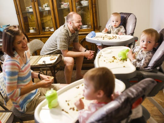 Chris and Marcella Hines feed their triplets, James,