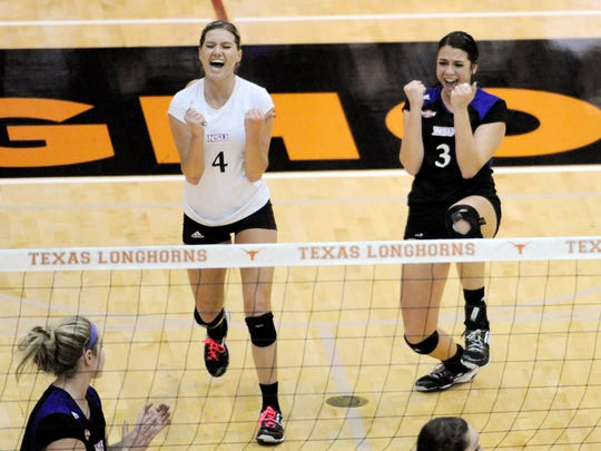 Northwestern State sophomore libero Bailey Martin (4) and senior outside hitter Stacey DiFrancesco (3) celebrate winning a point against No. 2 Texas during the first round of the NCAA volleyball tournament on Thursday.