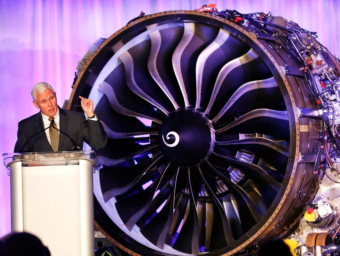 Gov. Mike Pence speaks as GE Aviation announces the company's plans to locate a new $100 million jet engine assembly in Lafayette, Ind., March 26, 2014, at the Purdue University Airport in West Lafayette. The 225,000 square-foot facility will assemble the new LEAP jet engine.