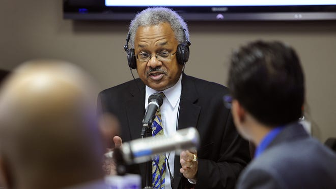 Amos Brown questions Indiana District 7 Democratic Representative Andre Carson and Republican candidate Carlos May during Brown's show on WTLC-AM, Oct. 22, 2012.