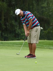 Ryan Gabel of Beacon putts during the second round