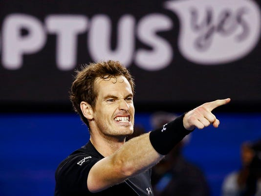 Murray of Britain celebrates defeating Berdych of Czech Republic in their men's singles semi-final match at the Australian Open 2015 tennis tournament in Melbourne