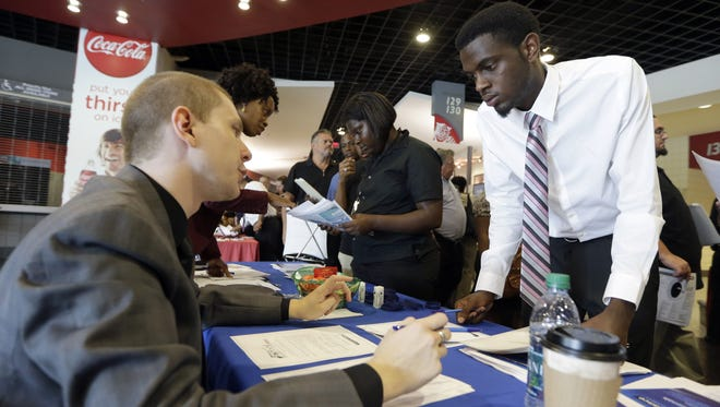 Job fairs like this one have been bustling recently as hiring has picked up.