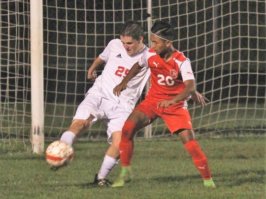 Dixie Heights' Ceu Bik battles then St. Henry senior Brad Esselman, left, and for the ball during St. Henry's 2-1 win over Dixie Heights in the 34th District boys soccer final Oct. 11, 2017 at St. Henry District High School in Erlanger, Ky.