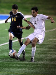 Abilene High's Andrew Vasquez (14) steals the ball