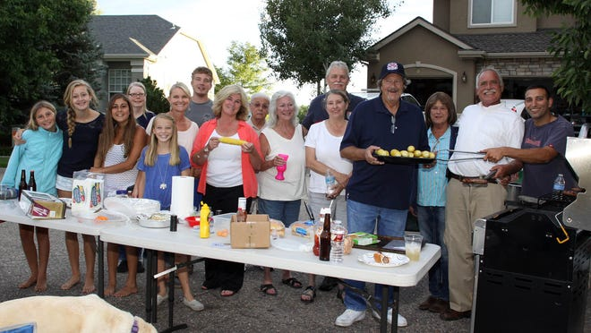 Residents of the cul de sac on Teal Court in Windsor celebrate National Night Out on Tuesdasy by having a corn roast.