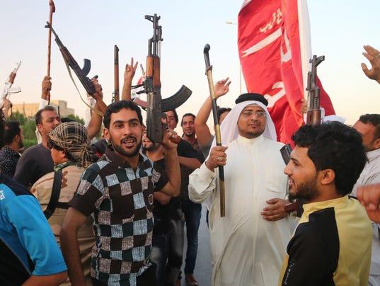 AP Mideast Iraq Shiite Militias