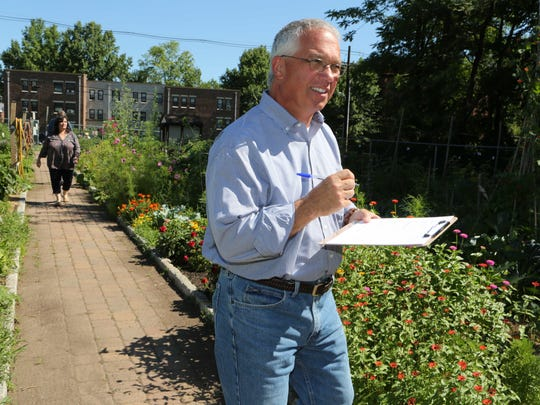 Judge Jim Politi, the Village of Nyack Administrator, takes notes as the Nyack Community Garden held their annual contest July 23, 2015.  Five judges judged over 50 plots in five categories including Best Vegetable, Best Flowers, Best Maintained, Most Creative and Best Overall. This is 35th year that the contest was held.
