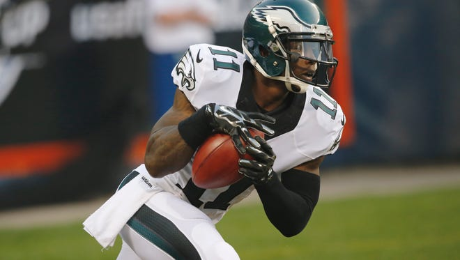 Philadelphia Eagles' Josh Huff (11) runs on a kickoff return in the first half of an NFL preseason football game against the Chicago Bears Friday, Aug. 8, 2014, in Chicago. (AP Photo/Charles Rex Arbogast)