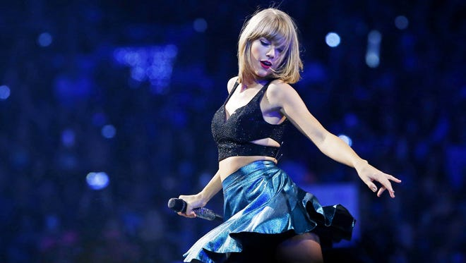 """Taylor Swift performs during her """"1989"""" world tour at Gila River Arena in Tuesday, August 18, 2015 in Glendale, Ariz."""