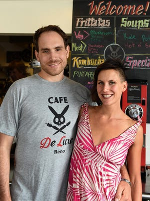 Cafe DeLuxe owners Rich Selden and Katie DiLibero take five at their Midtown restaurant, known for its vegetarian and vegan food. They got their start in the business as food truck operators.