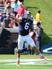 University of Virginia quarterback Kurt Benkert throws a pass during the Cavaliers win over Central Michigan on Saturday. Benkert broke the program's single-game passing record with 421 yards.