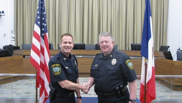 Bill Campbell, left, is seen here on his promotion to Iowa City Police Captain on May 11, 2016 shaking hands with ICPD Chief Sam Hargadine.