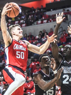 Mississippi's Justas Furmanavicius (50) shoots against Mississippi State's Aric Holman (35) and Abdul Ado (24) during an NCAA college basketball game in Oxford, Miss., Saturday, Jan. 6, 2018. (Bruce Newman/The Oxford Eagle via AP)
