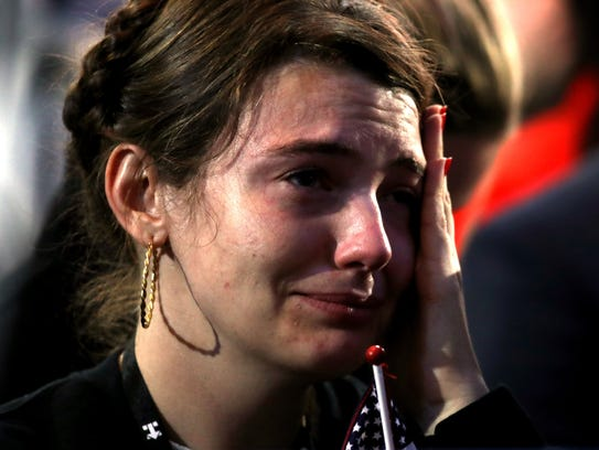 A woman cries during what was supposed to be Clinton's