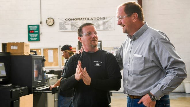 Engineering Plant Manager Eric Hicks, right talks with Processor Tony Goode about the day's productivity at the Jones Plastic & Engineering Company, in Camden, Tenn., Tuesday, Nov. 28, 2017.