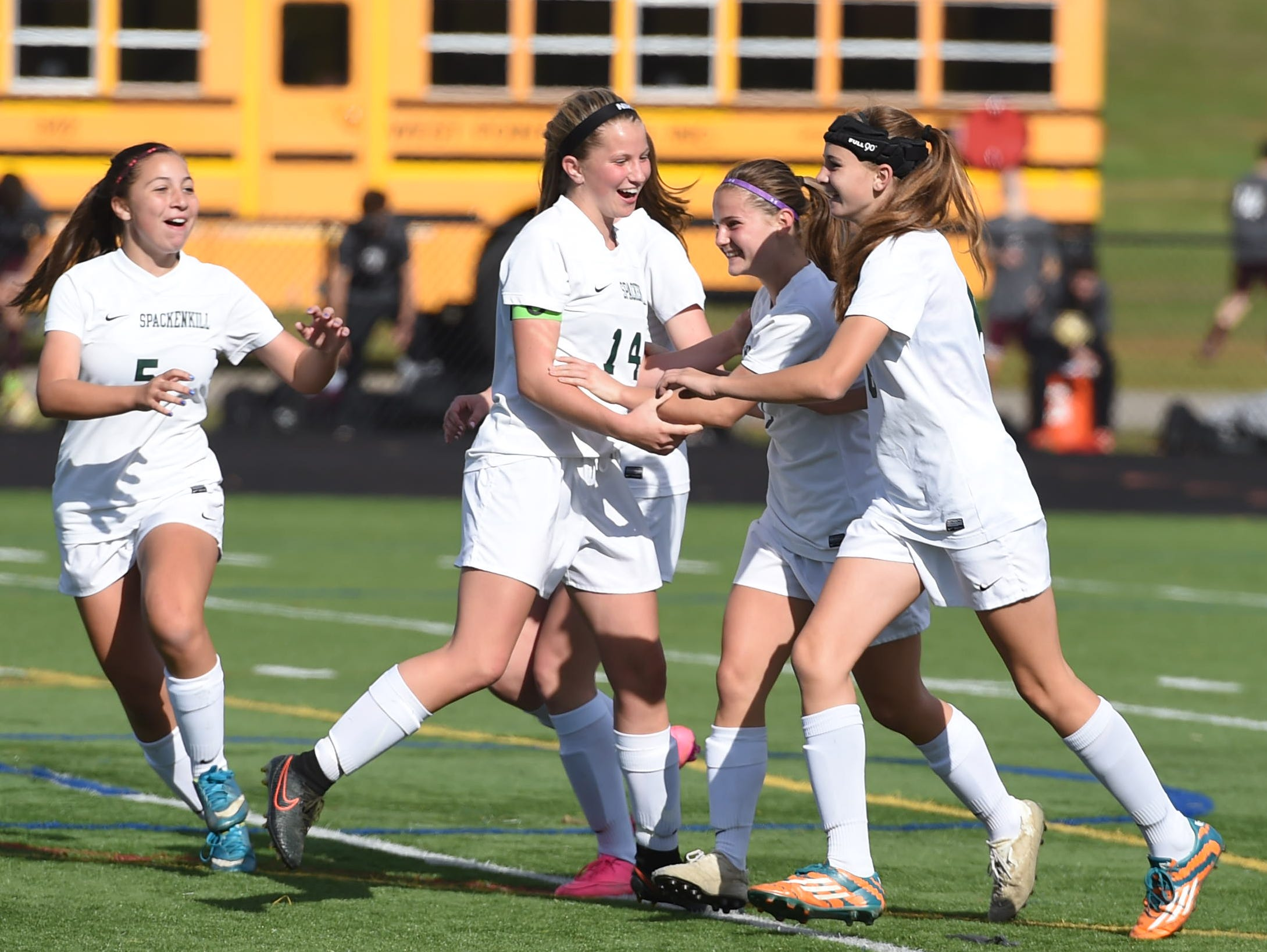 From left, Spackenkill's Caitlin Speranza, Katherine Lillis, Maria Barefoot, and Kaitlin Kilpert celebrate the goal Barefoot got on Rhinebeck during the Section 9 Class C final held in Marlboro on Saturday.