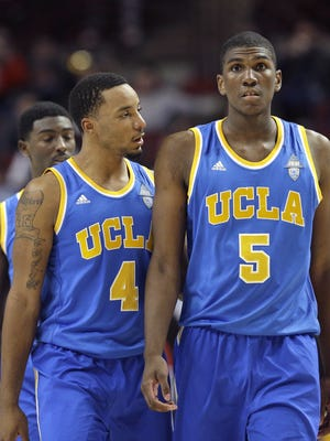 UCLA guard Norman Powell (4) talks to forward Kevon Looney during the second half against Kentucky on Dec. 20, 2014, in Chicago.