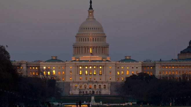 This March 22, 2013, file photo shows the setting sun reflected in the windows of the U.S. Capitol in Washington. If thereís one word that describes how Americans feel about politics these days, itís ìnegative.î Majorities disapprove of Congress and the president and say the nation is heading in the wrong direction. Few trust their political leaders to make the right decisions, and some polls suggest voters would like to see the whole lot turned out next November.  (AP Photo/Alex Brandon) ORG XMIT: WX101