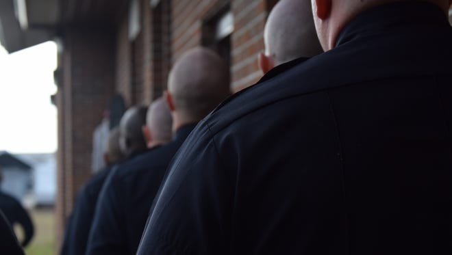 Recruits line up for outdoor drills Monday during the 33rd class of the current Hattiesburg police academy.